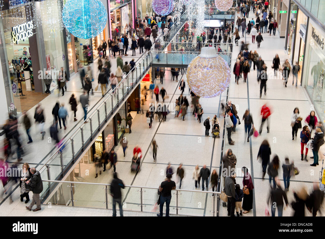 Manchester, UK. 22nd December, 2013. An internal shot of Manchester Arndale shopping centre during the Christmas lead up period. Over 210 stores are located within the bustling shopping complex. Credit:  Russell Hart/Alamy Live News - Stock Image