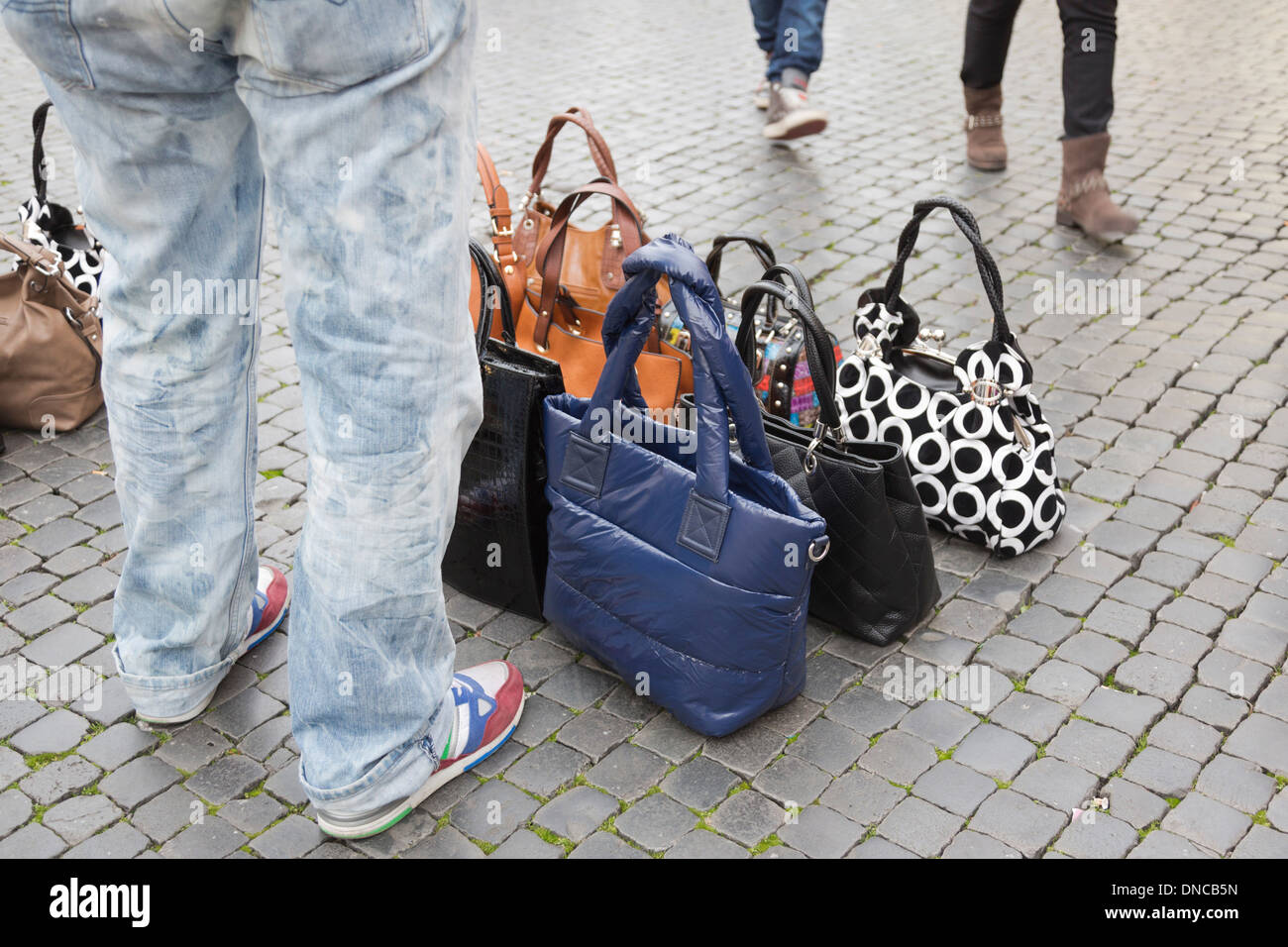 Immigrant to Italy selling fake designer handbags in Piazza Navona da2695575c077