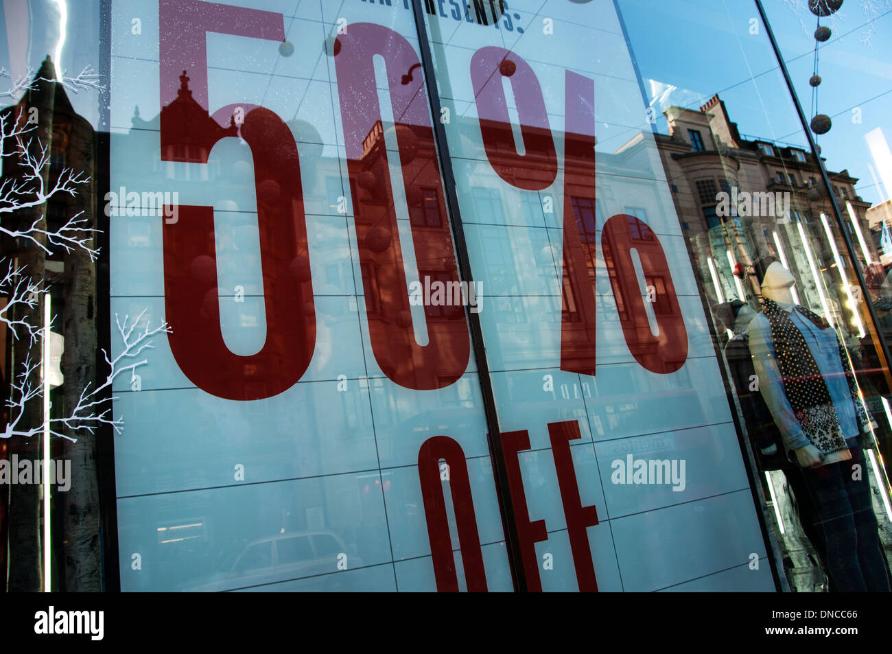 97e0d8c900205 London. Christmas 2013. Shopping. Sales . Sign in shop window saying  50