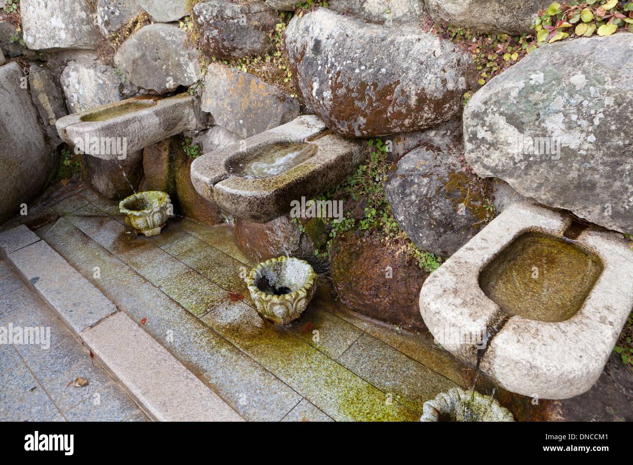 Natural spring water sink at Buddhist temple - Gyeongju, South Korea - Stock Image