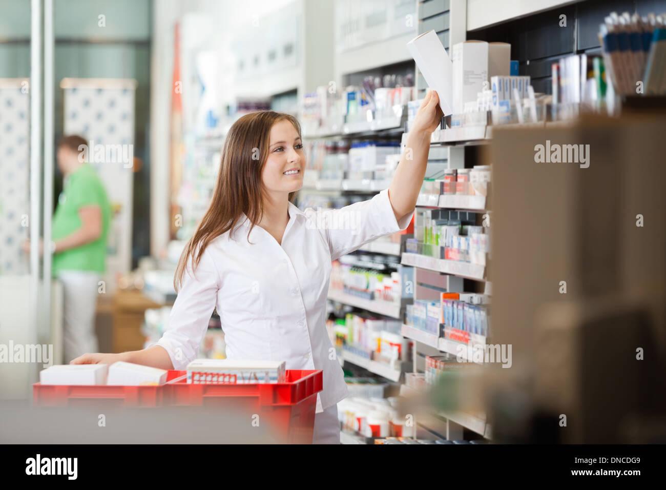 Pharmacist Stocking Shelves Stock Photo