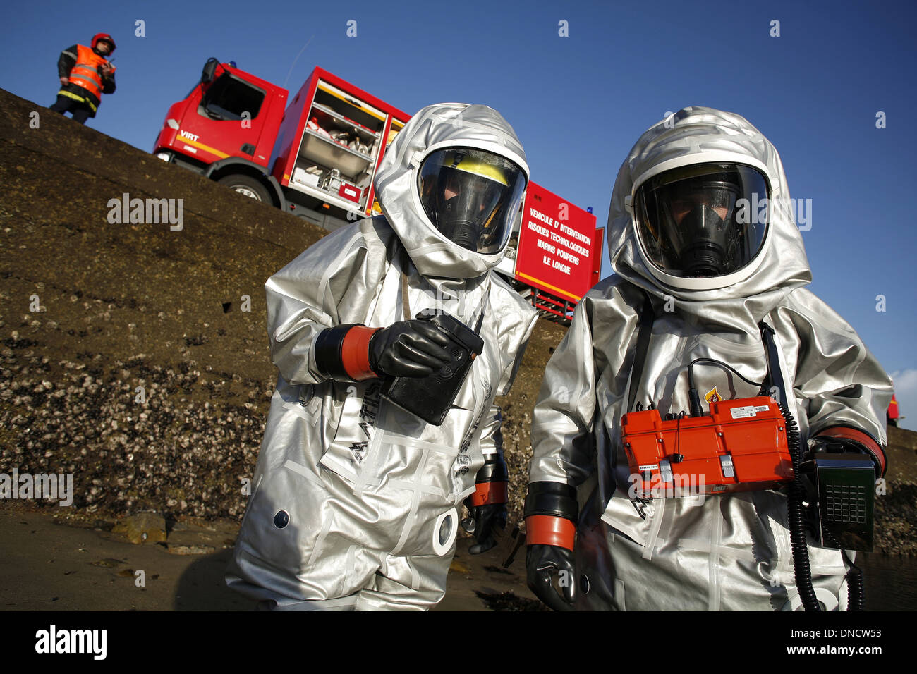 Fire team specialized in chemical, biological, radiological and nuclear defense (CBRN defense or CBRND) - Stock Image