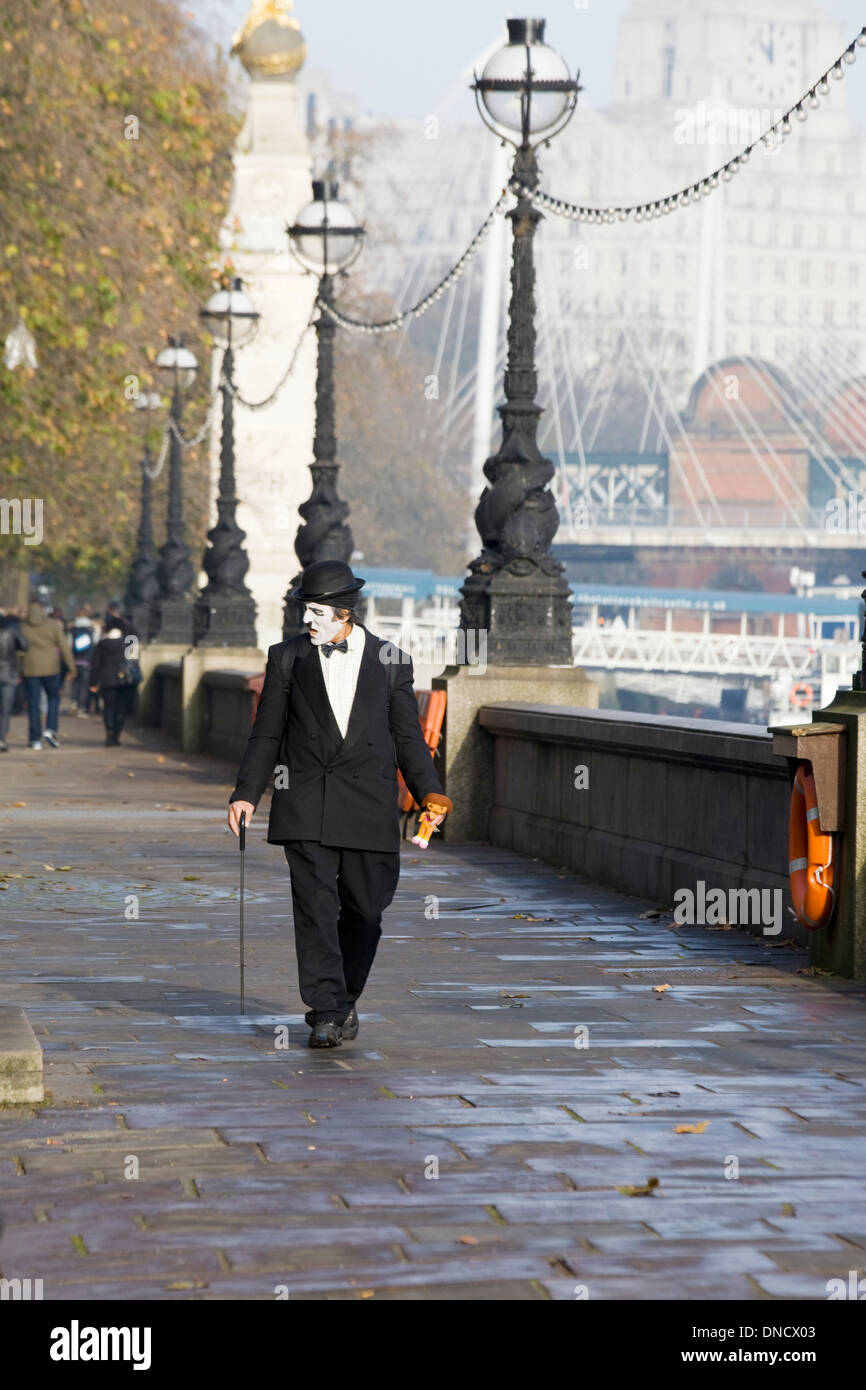 Mime Artist Strolling down the walkway along the River Thames London - Stock Image