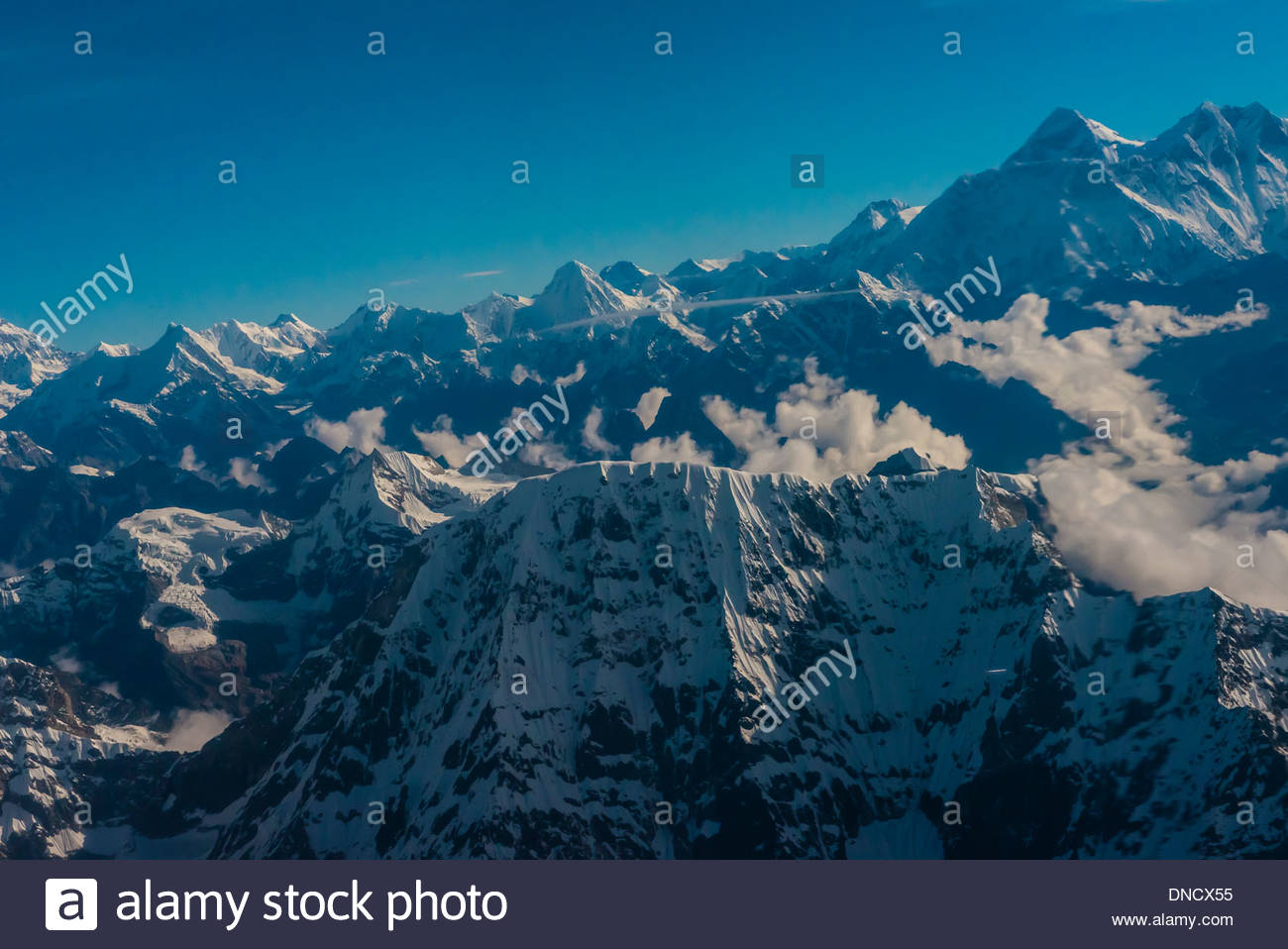 Aerial view of the high peaks of the Himalayan Range, near Mt. Everest, Nepal. - Stock Image