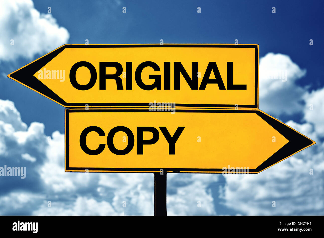 original or copy title on opposite direction street sign - Stock Image