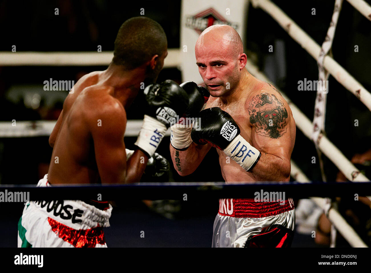 21.12.2013 Elche Spain. Jeffrey Mathebula of Shouth Africa (L) and Kiko Martinez of Spain in action during the Super Bantamweight World championship boxing title fight between Kiko Martínez of Spain and Jeffrey Mathebula of Shouth Africa at the Esperanza Lag Arena, Elche Stock Photo