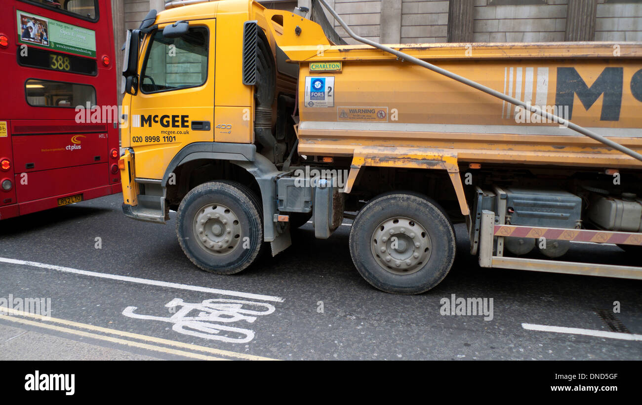 A McGee HGV lorry in traffic and cycling cycle lane sign logo on road London UK KATHY DEWITT - Stock Image