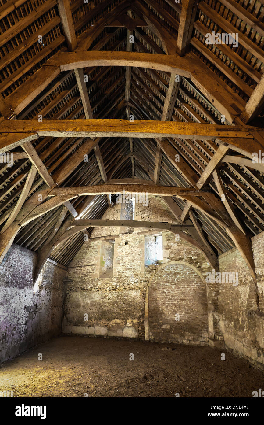 Medieval Tythe Barn in the village of Lacock in Wiltshire UK - Stock Image