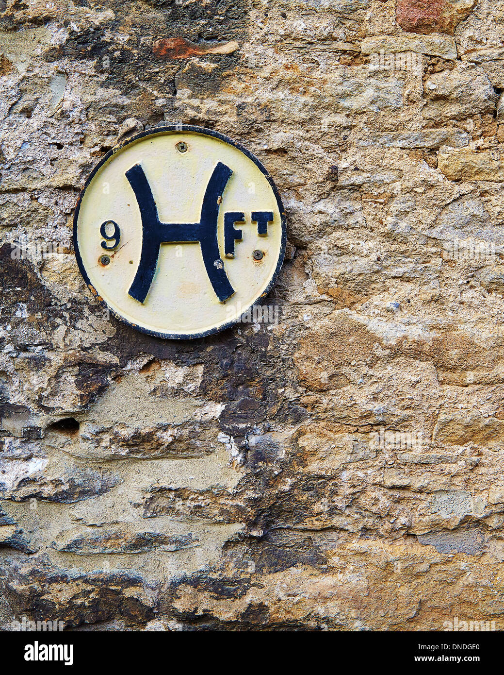 Antique fire hydrant sign on a stone wall in the Wiltshire Cotswolds UK - Stock Image