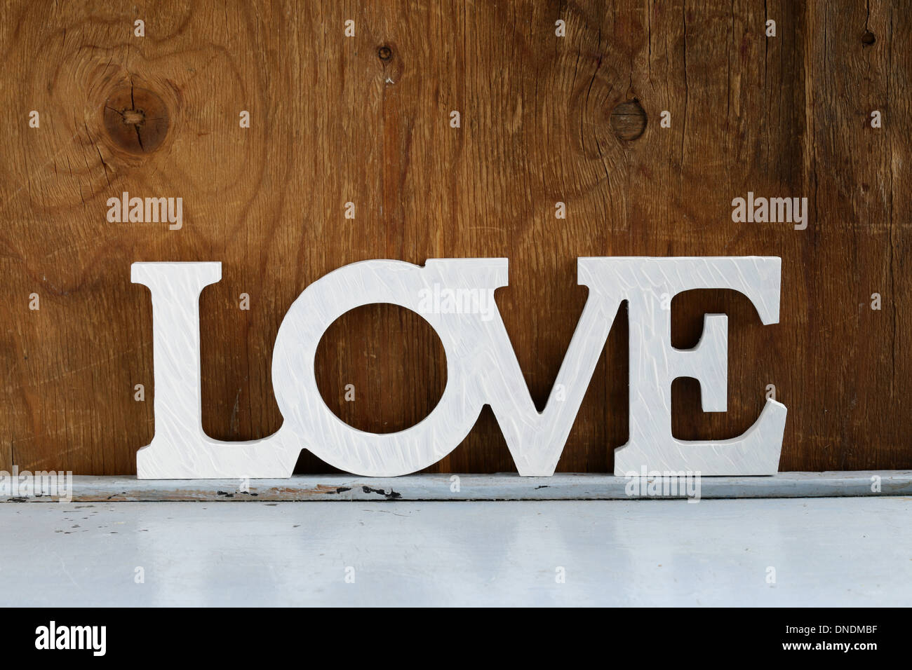 word love made of white wooden letters on vintage background