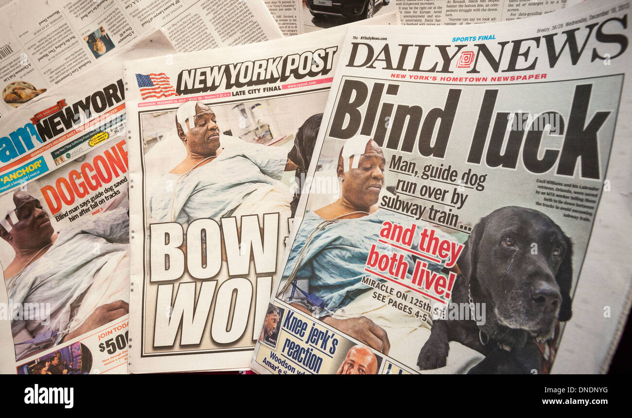 The covers of the New York tabloids run the same Associated Press photograph of Cecil Williams in his hospital bed - Stock Image
