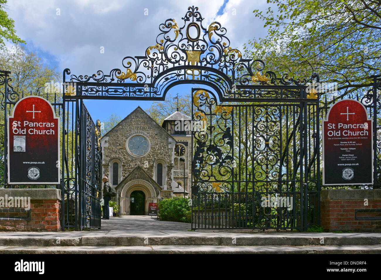 Ornamental iron gates to the church and churchyard of St Pancras Old Church - Stock Image