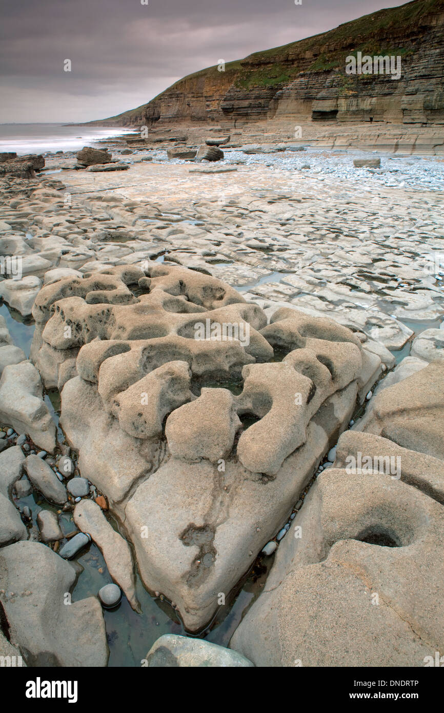Rock formations at Dunraven Bay, South Wales, are caused by the power of the sea. Stock Photo