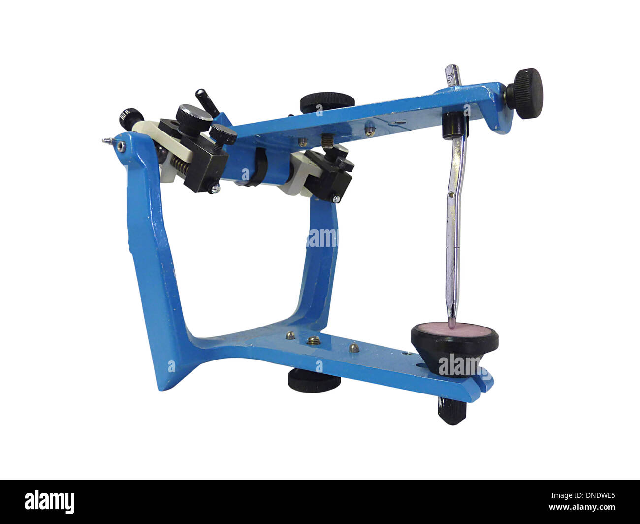 Blue metallic articulator used in dentistry. - Stock Image