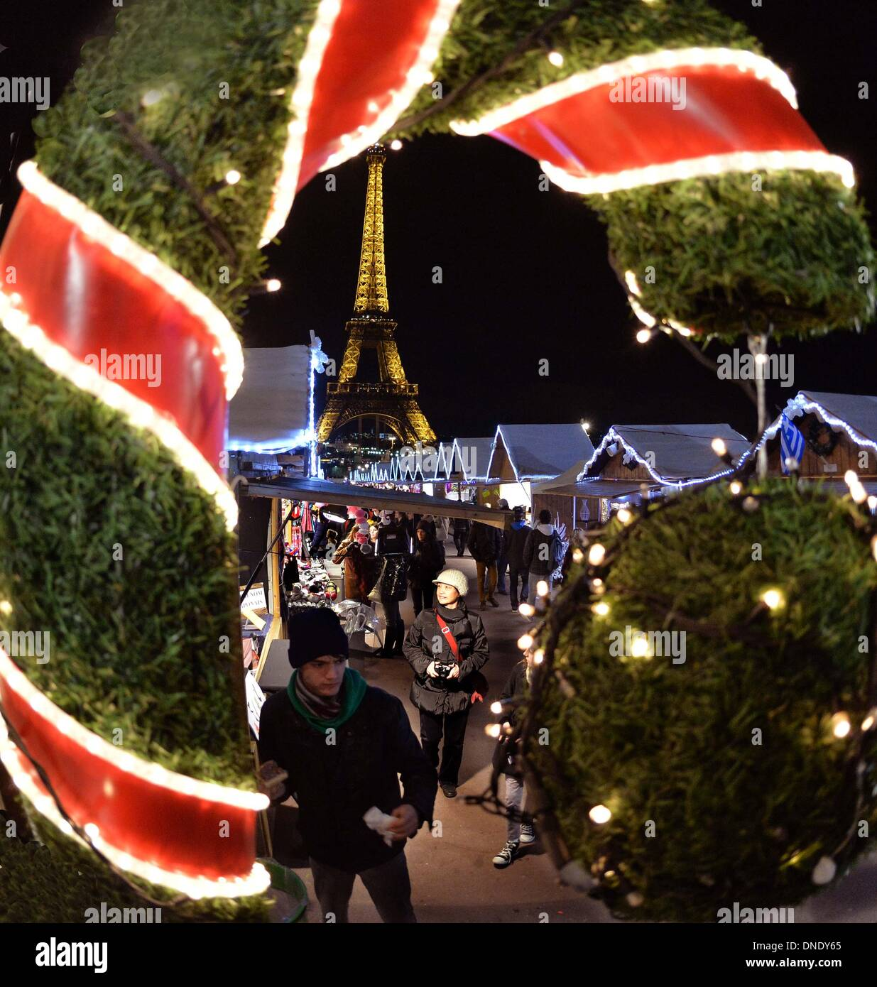 Paris, France. 23rd Dec, 2013. People shop at a night market in ...
