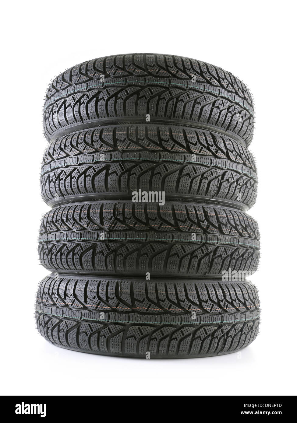 Pile of four winter car tyres shot on white - Stock Image
