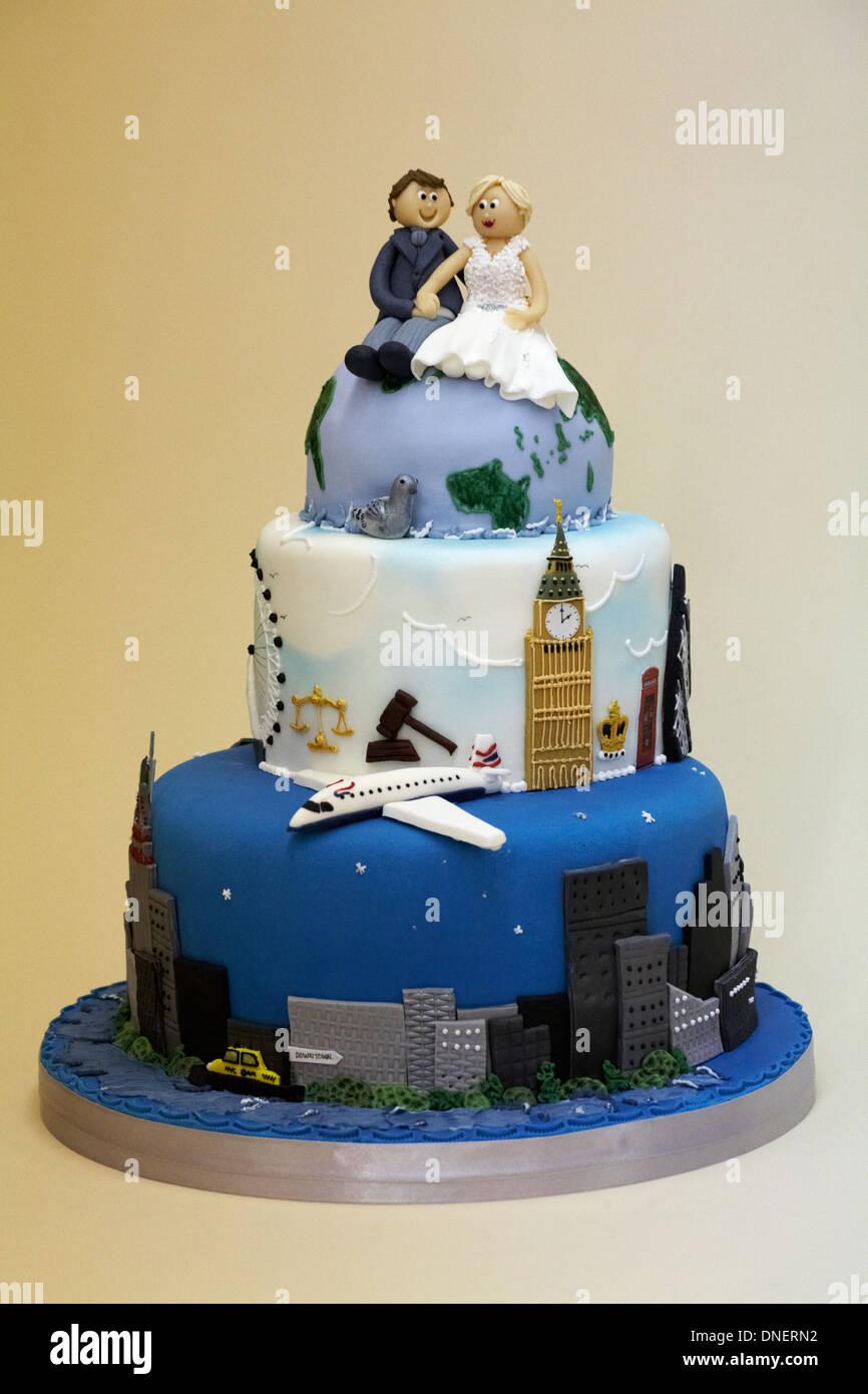 Wedding Cake With Couple Sitting On Globe Travelling The