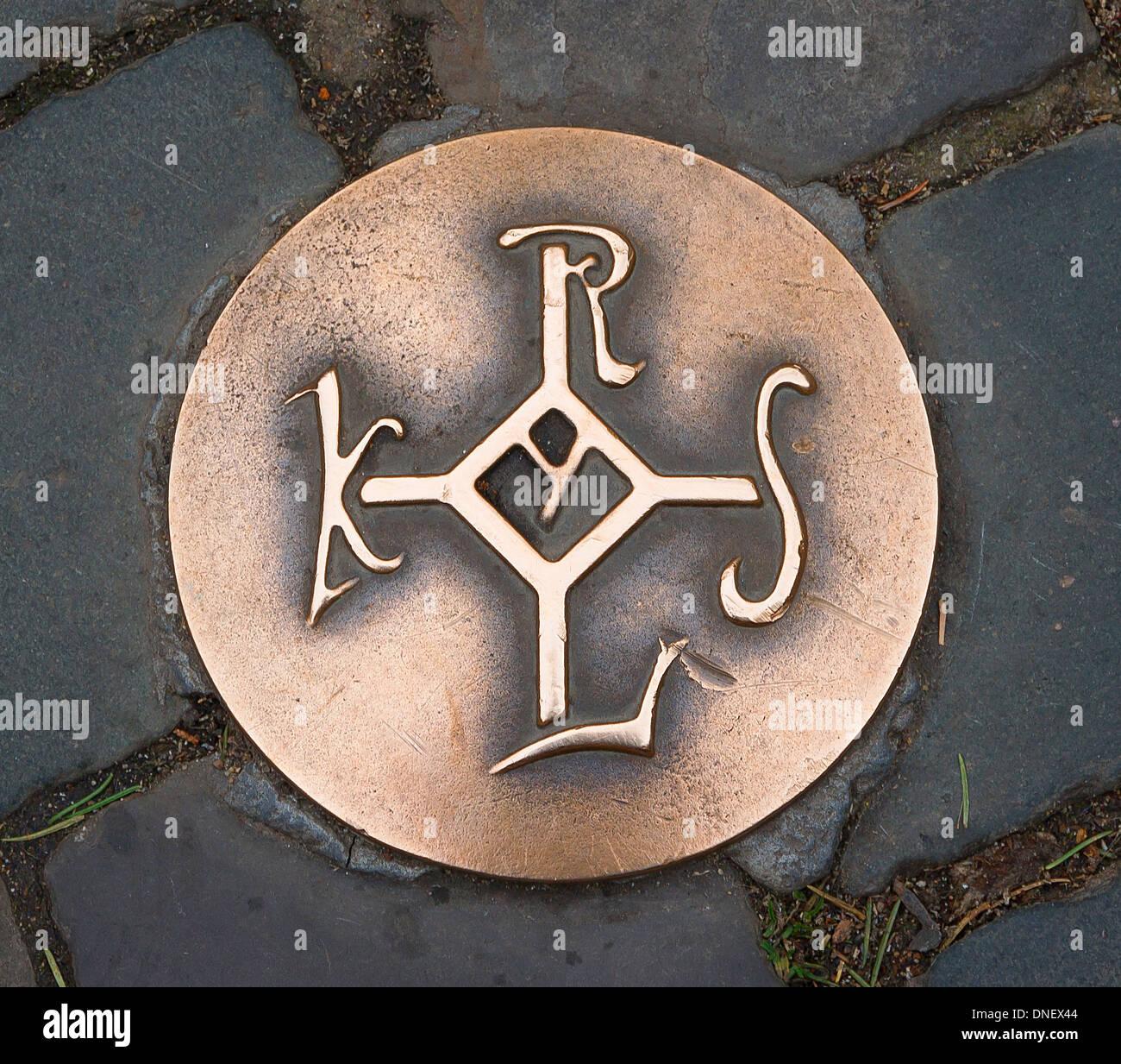 Monogram of Carolus Magnus, on the ground of the Münsterplatz, Aachen, Germany. - Stock Image