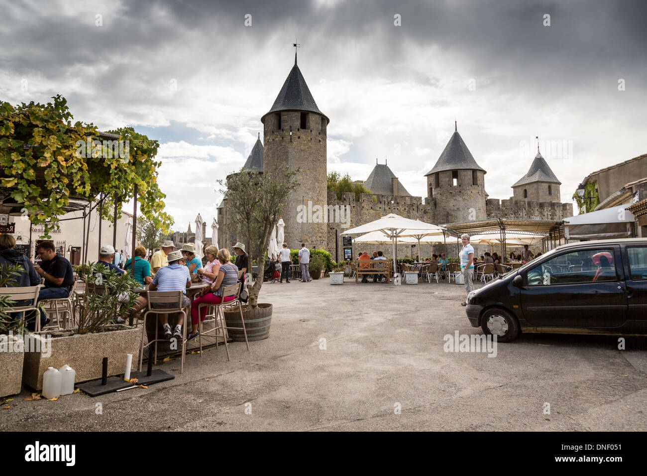 Carcassonne. France, Europe. Tourists in the cafés and restaurants in the old square of Place Saint Jean. Stock Photo