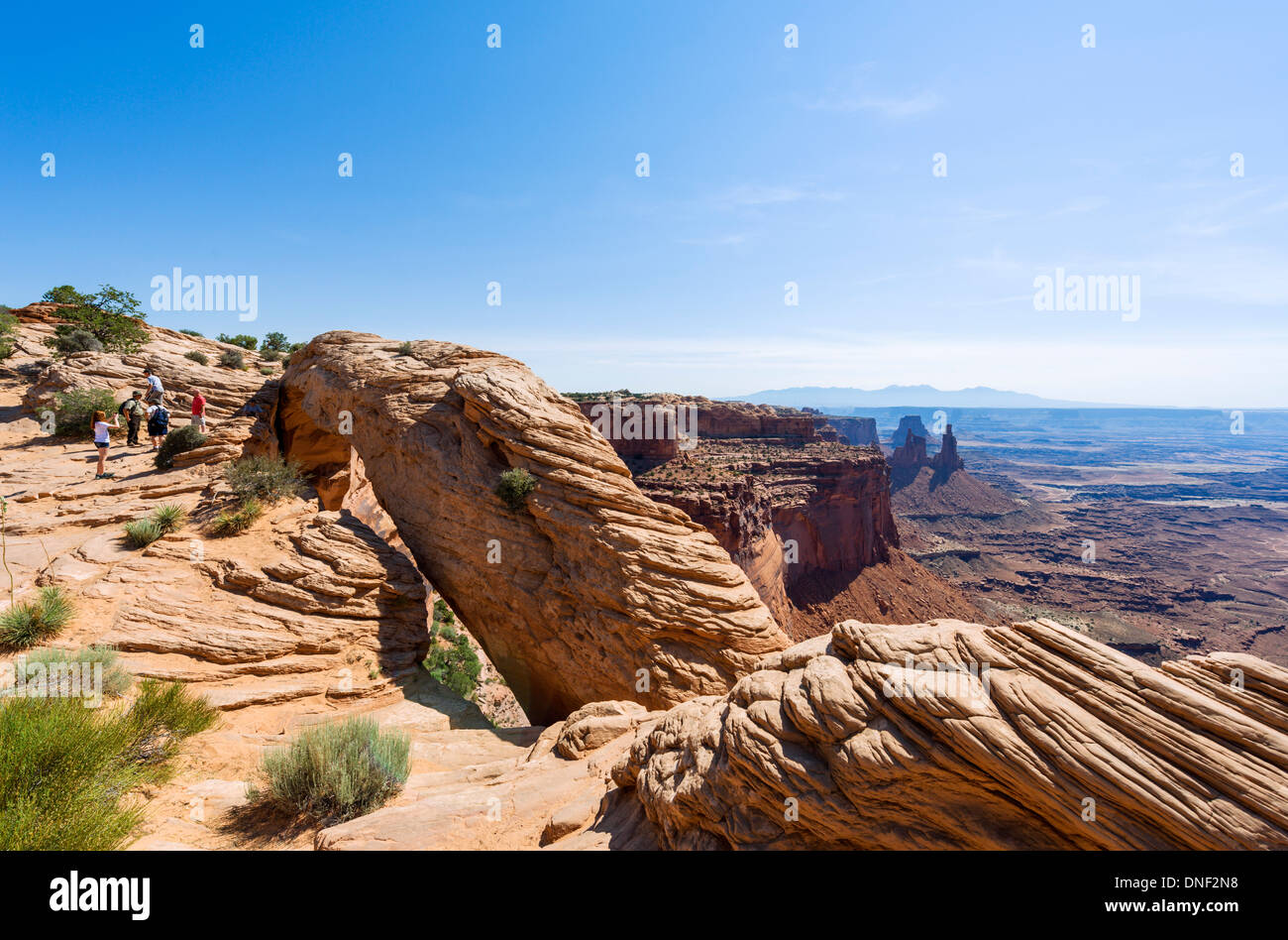 Tourists at Mesa Arch, Island in the Sky, Canyonlands National Park, Utah, USA - Stock Image