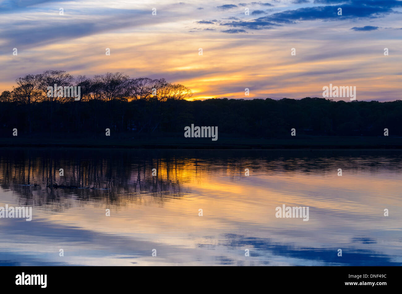 The sun sets over a salt marsh in the late spring in Niantic East Lyme Connecticut United States May 2013. Taken Stock Photo