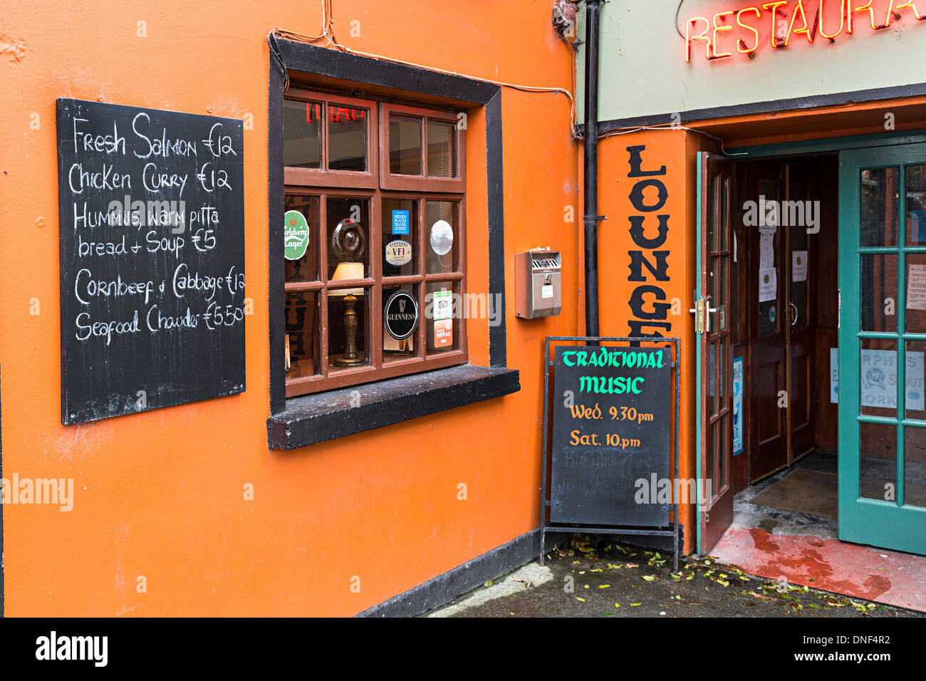 Signs for live music and menu outside bar and restaurant, Corofin, Co. Clare, Ireland - Stock Image