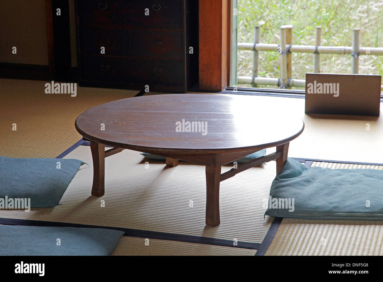A Chabudai traditional Japanese table in a Tatami mat room at Edo -Tokyo Open Air Architectural Museum Stock Photo