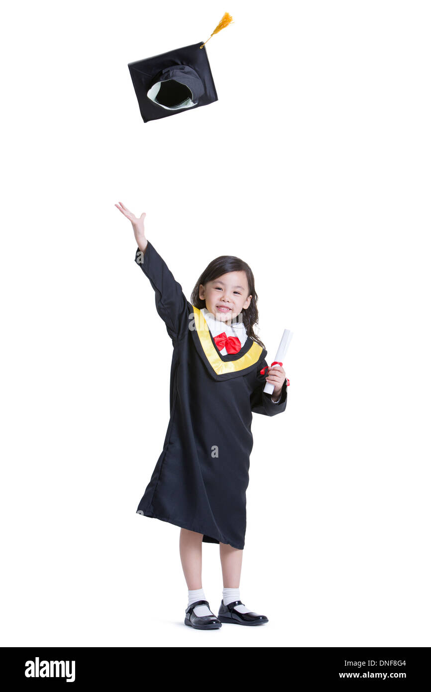 Cute girl in graduation gown Stock Photo: 64874884 - Alamy