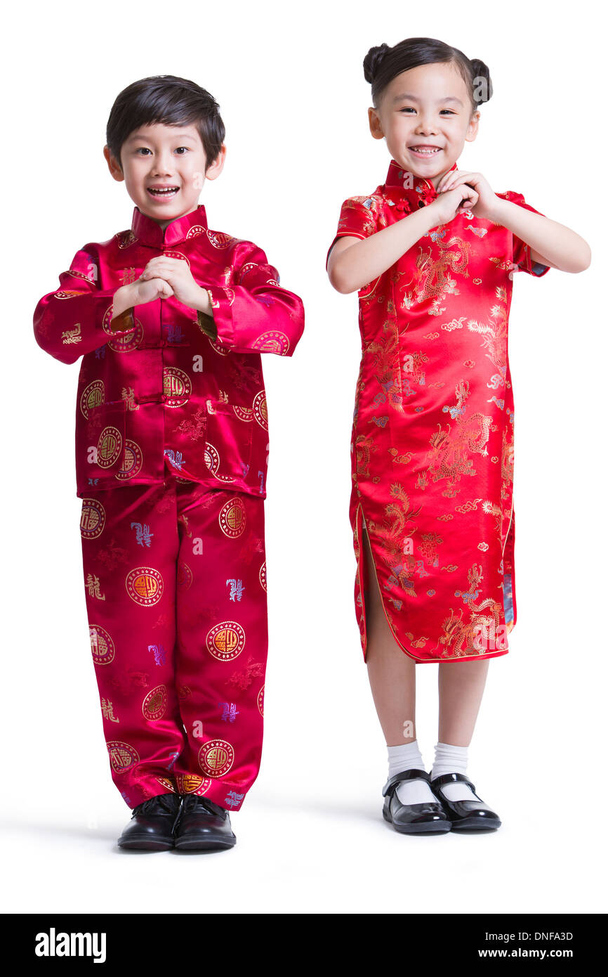 cute children in traditional clothing celebrating chinese new year stock photo 64876097 alamy. Black Bedroom Furniture Sets. Home Design Ideas
