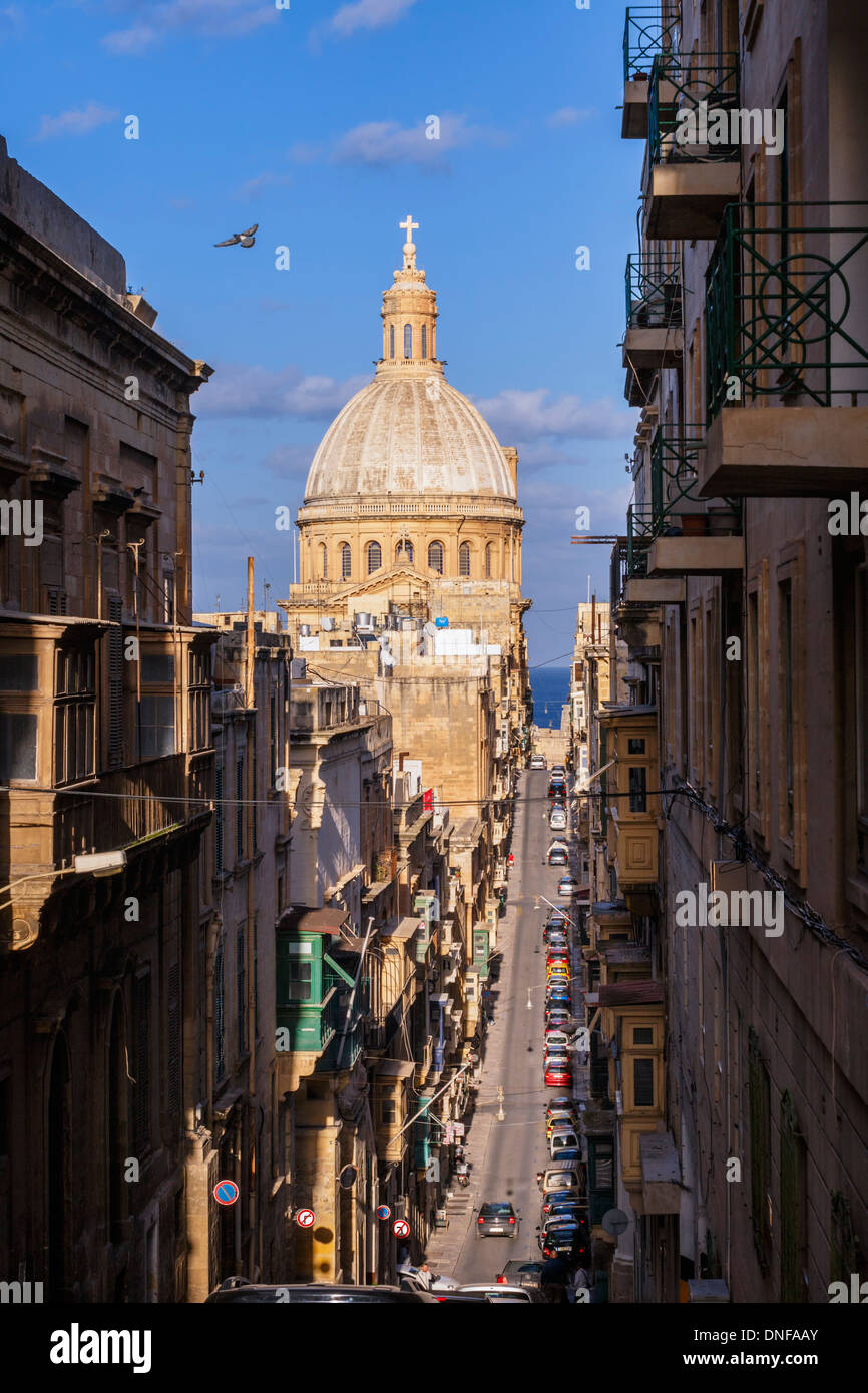 Mint Street in Valletta with the dome of the Carmelite Church, Malta. - Stock Image