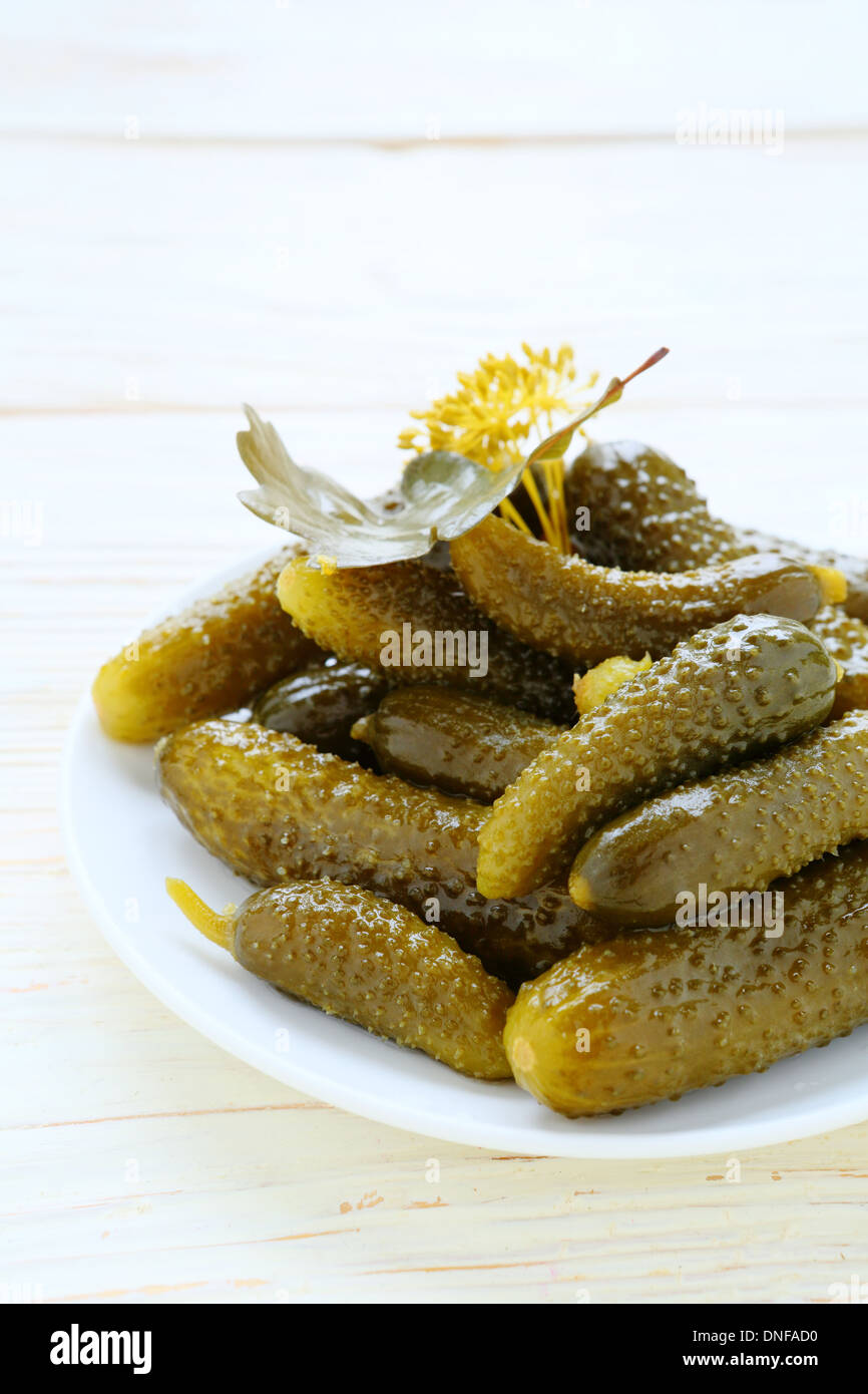 pickled gherkins on a plate, food closeup - Stock Image