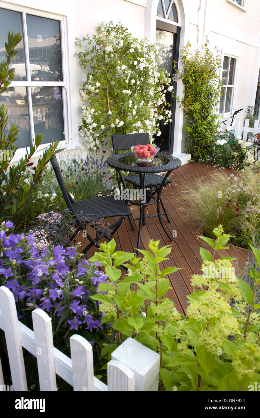 Decked patio in small town garden. Stock Photo
