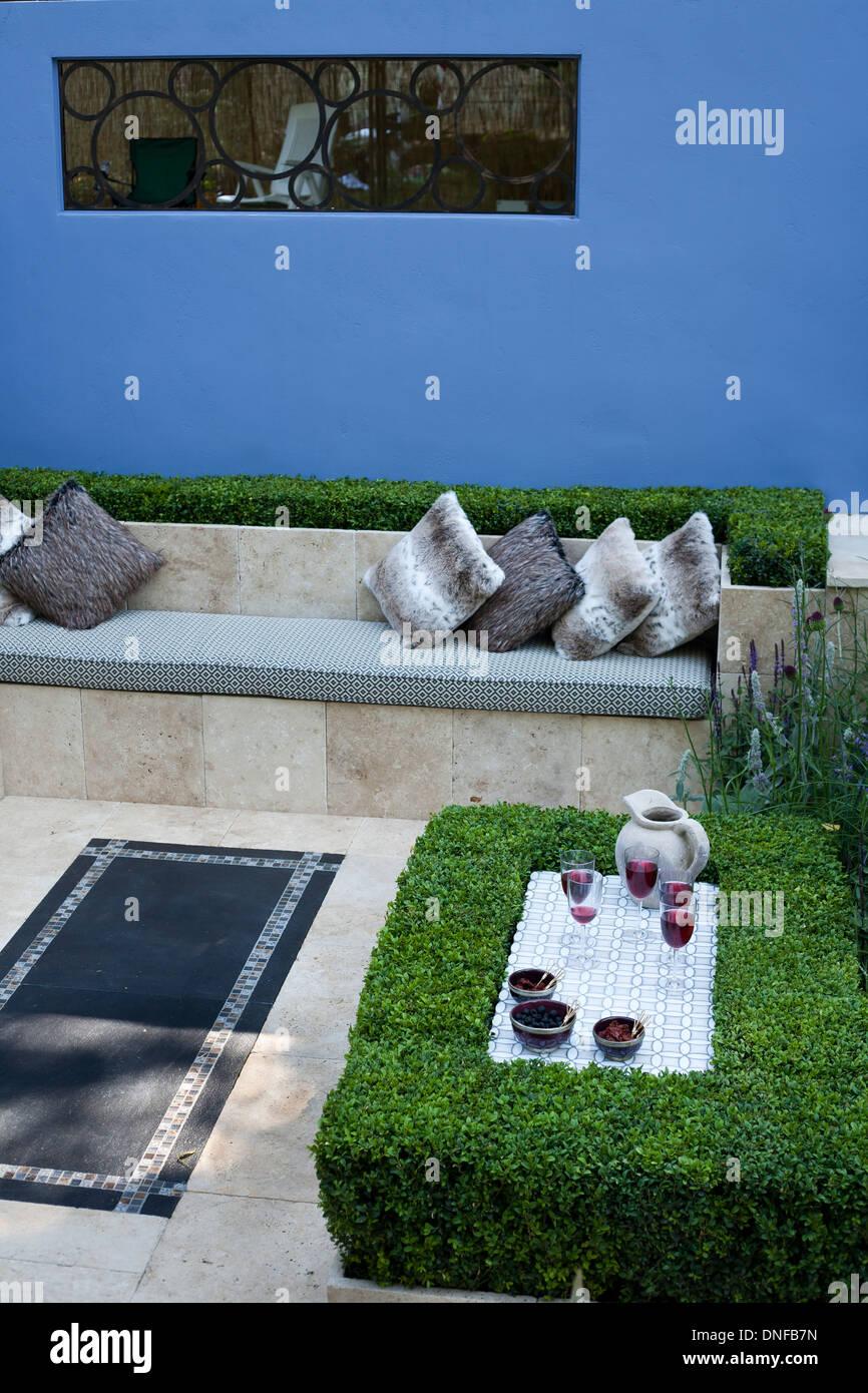 Relaxing area in contemporary garden. Stock Photo