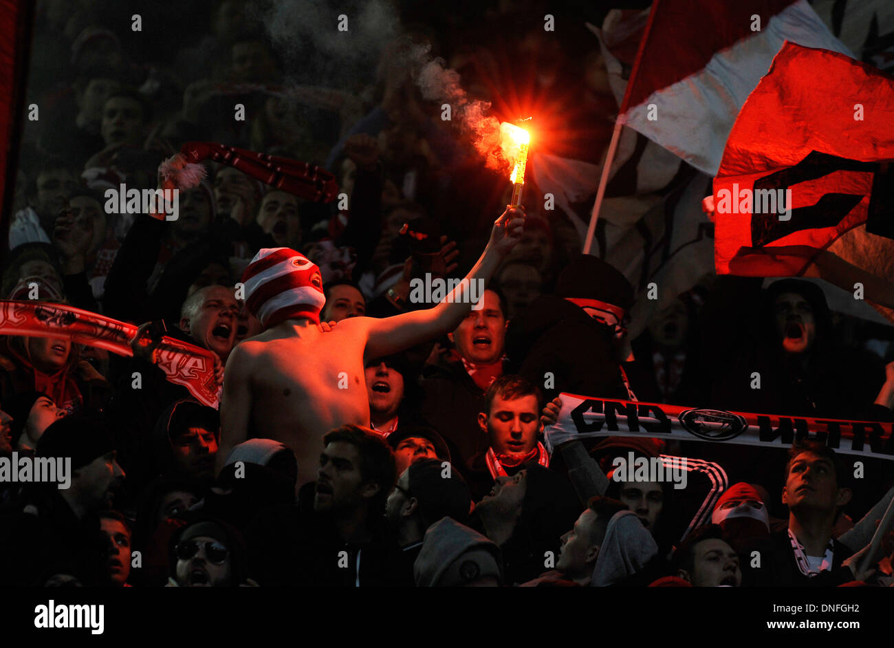 Supporters of German Football Bundesliga Club FC Köln (Cologne) celebrate their team burning flares Stock Photo