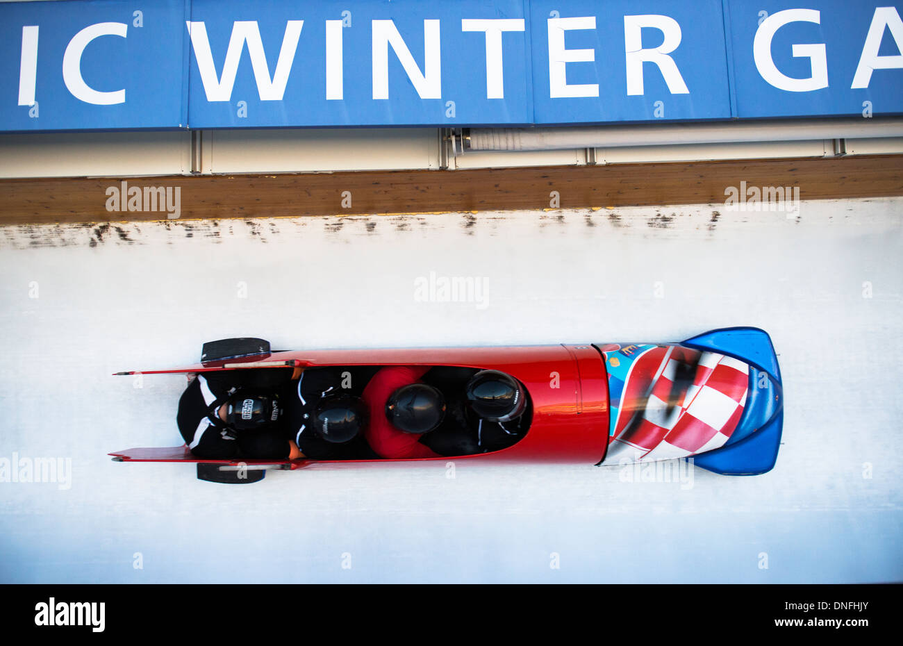 The Croat bobsled team racing on the ice track during an official tournament in the winter Olympic center in Park City, Utah. - Stock Image