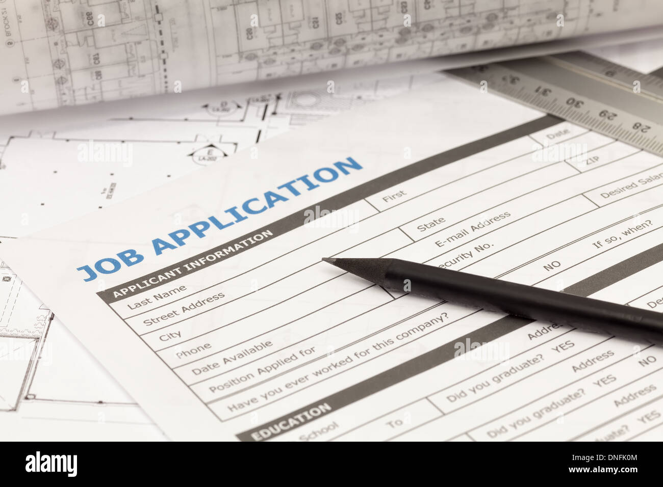 Job application form on architectural plan - Stock Image