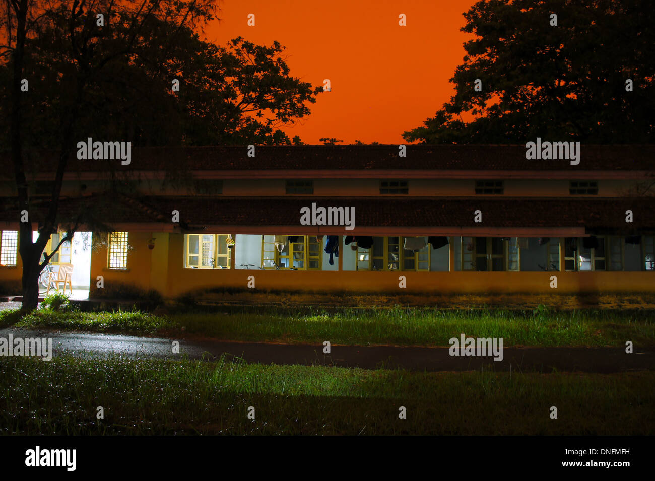 Home lit up at night, India - Stock Image