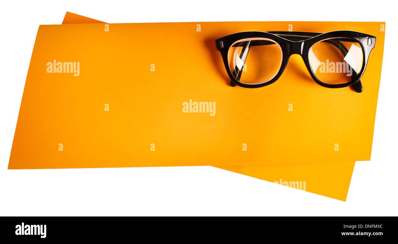 704a59fce1 Vintage eyeglasses with black frame on orange creative support Stock ...