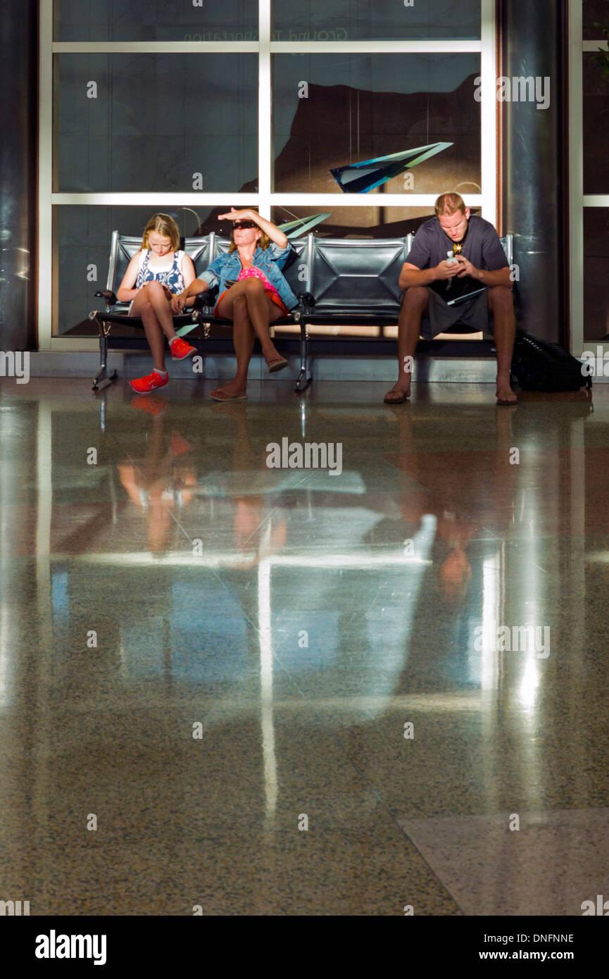 Travelers waiting at the Denver International Airport - Stock Image