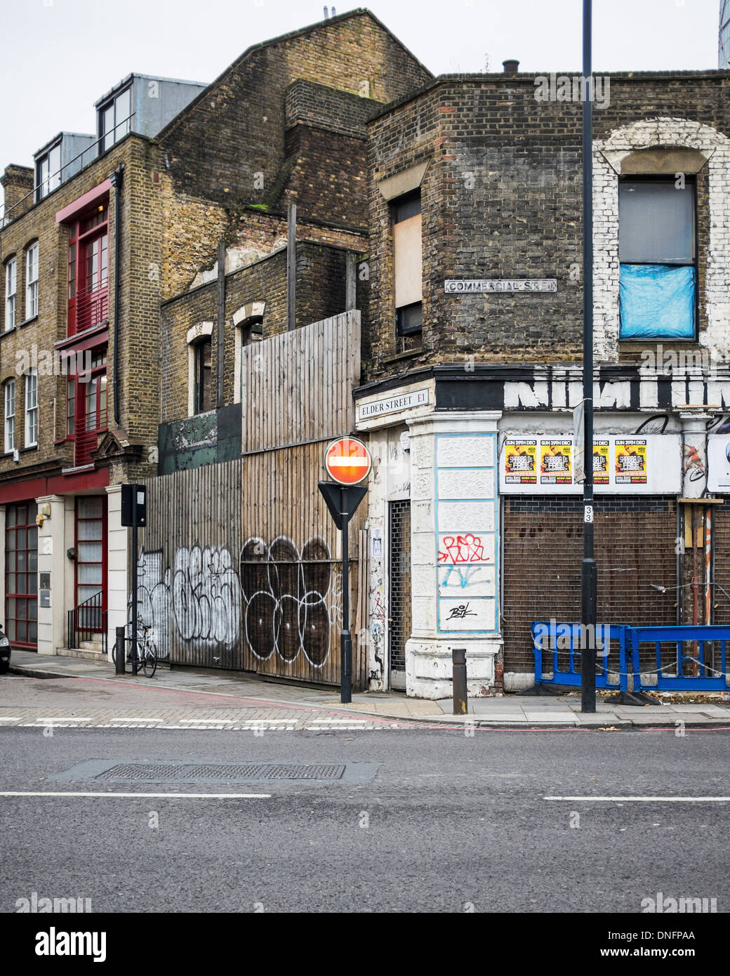Urban decay - decrepit and broken down old buildings on corner of Elder Street, London E1 - Stock Image