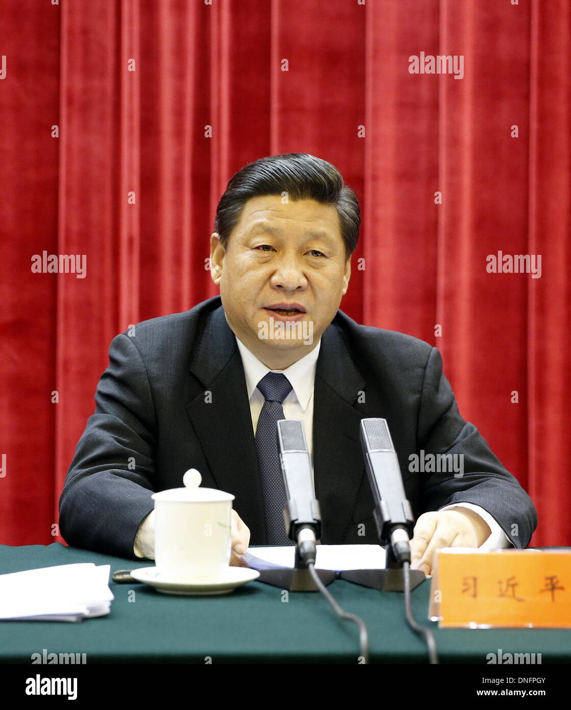 Beijing, China. 26th Dec, 2013. Chinese President Xi Jinping delivers a speech during a symposium commemorating the 120th anniversary of the birth of the late Chinese leader Mao Zedong in Beijing, capital of China, Dec. 26, 2013. Credit:  Ju Peng/Xinhua/Alamy Live News - Stock Image