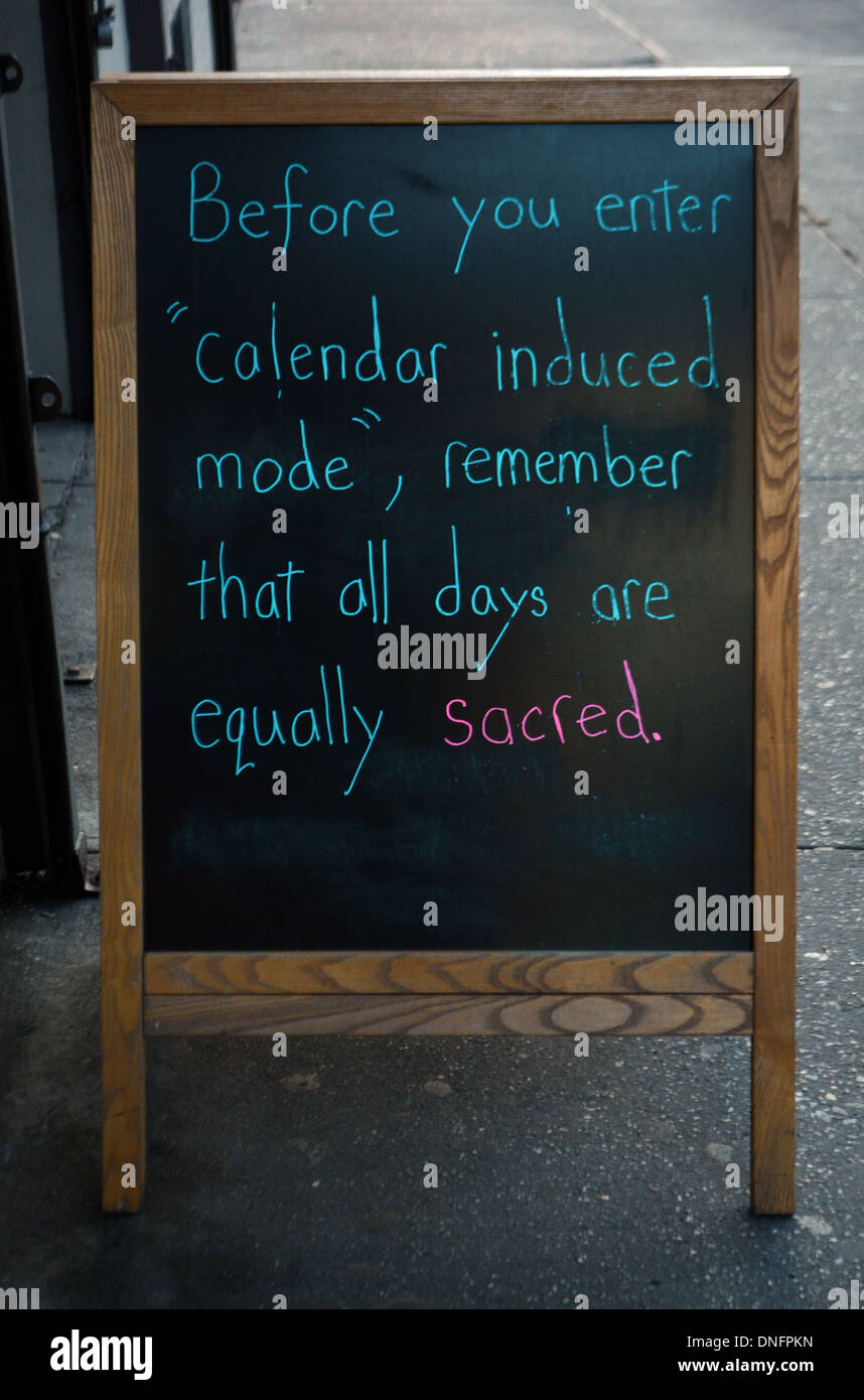 A chalk sign outside a food shop in Manhattan discouraging people from binge eating over the holidays. New York City - Stock Image
