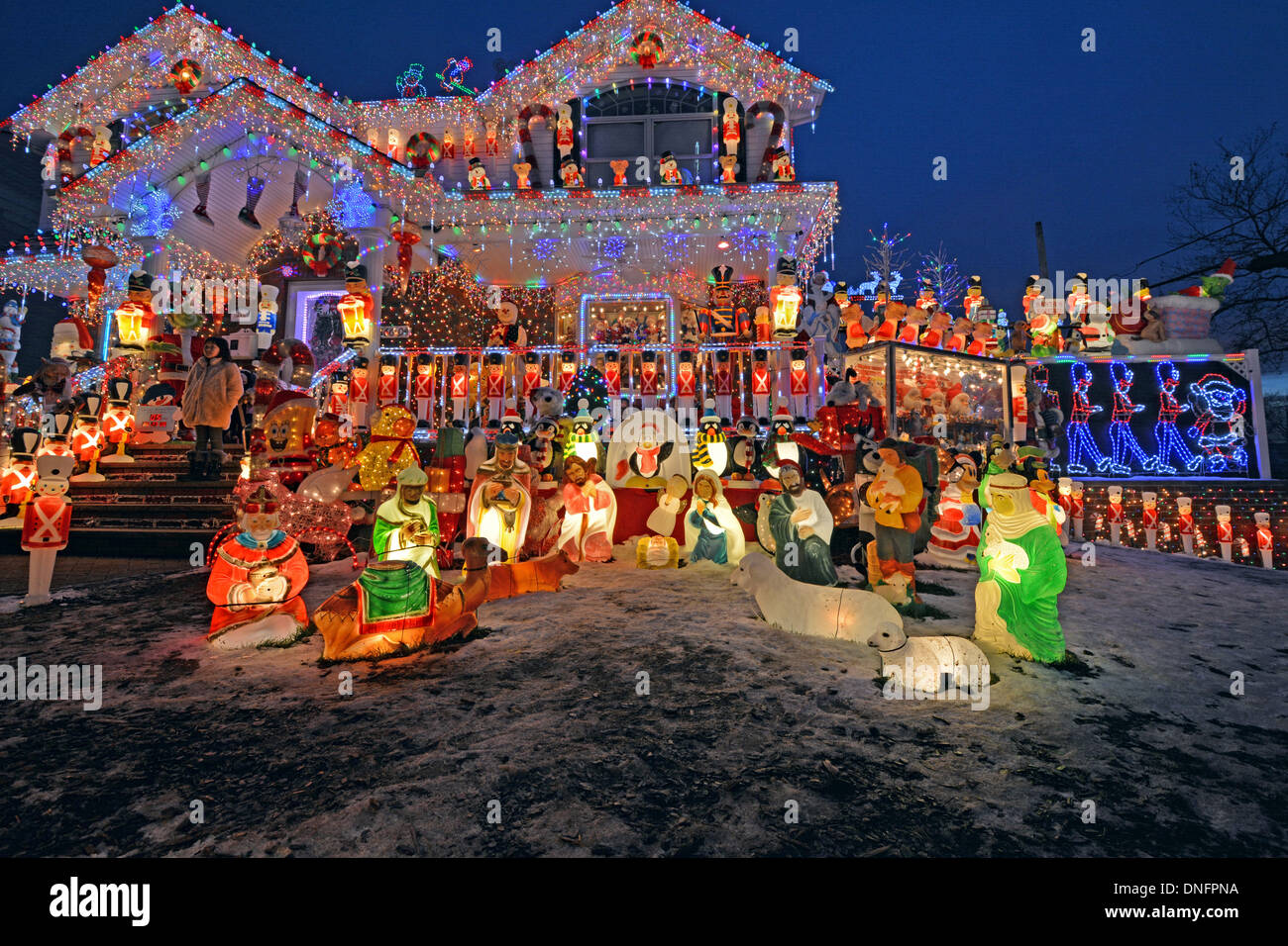 A house in Bayside, Queens, New York with elaborate lighting for Christmas. - Stock Image