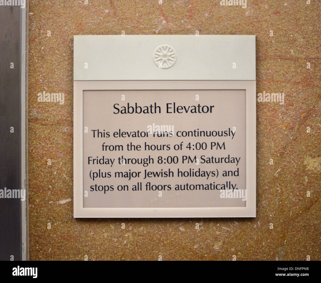 A sign for a Sabbath elevator in the lobby of New York Presbyterian