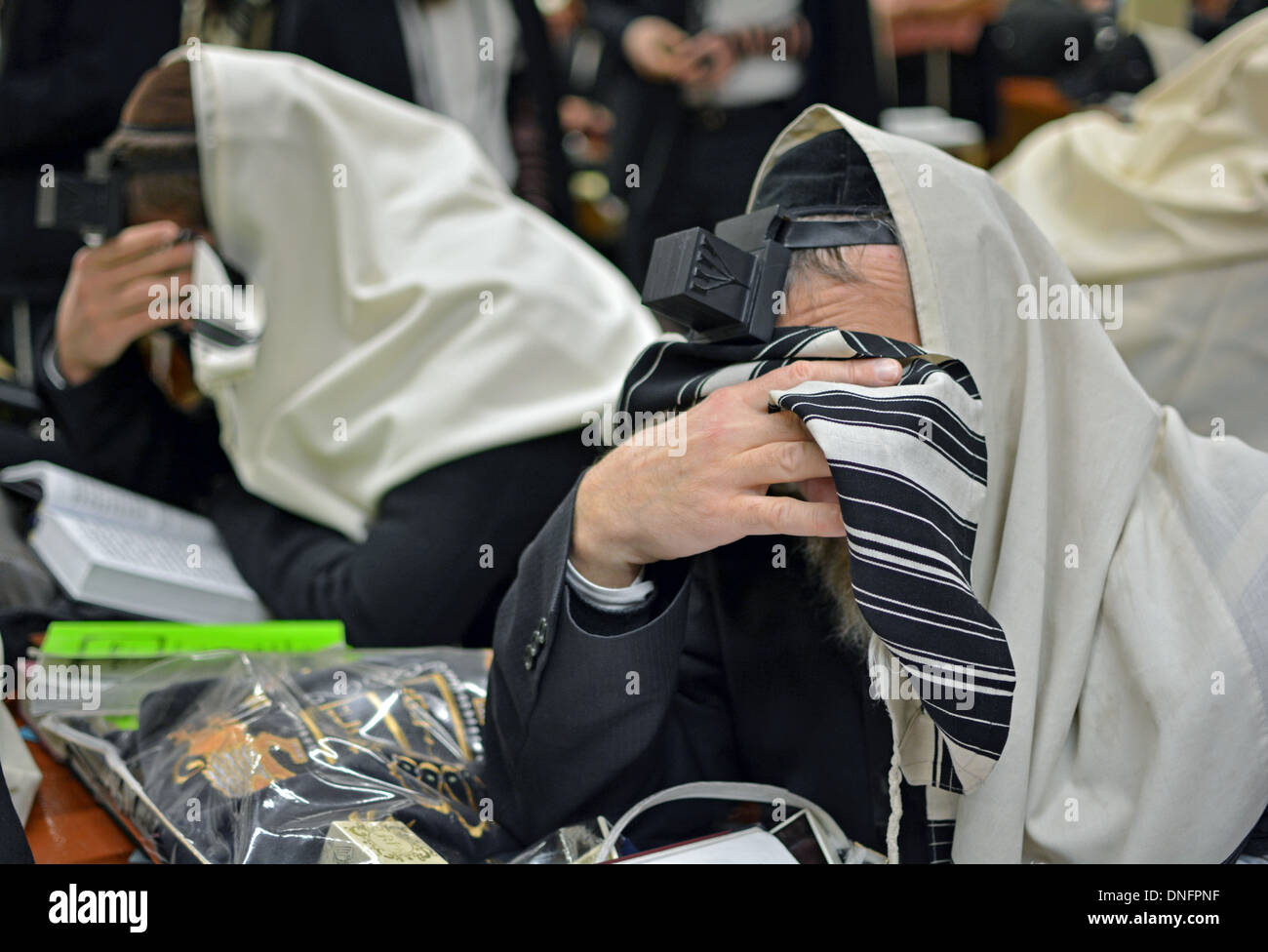 Religious Jewish men during morning prayers at Lubavitch main headquarters in the Crown Heights section of Brooklyn, New York - Stock Image