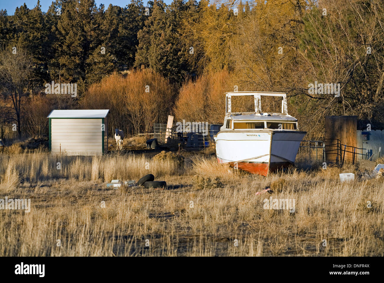 A badly neglected yacht sits in a field in central Oregon. - Stock Image