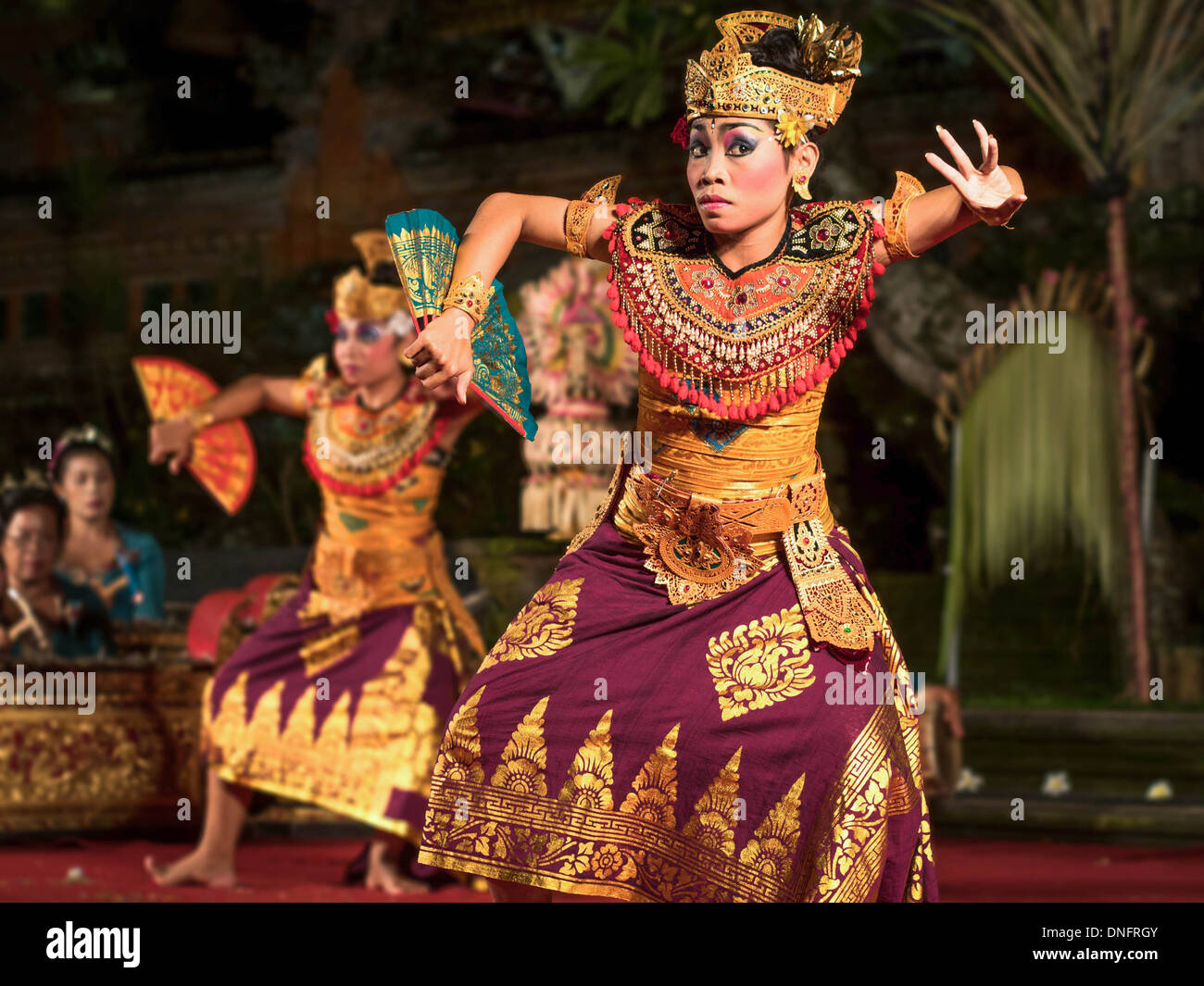 Dancers perform traditional Legong and Barong dance at open air theater in Ubud, Bali. - Stock Image