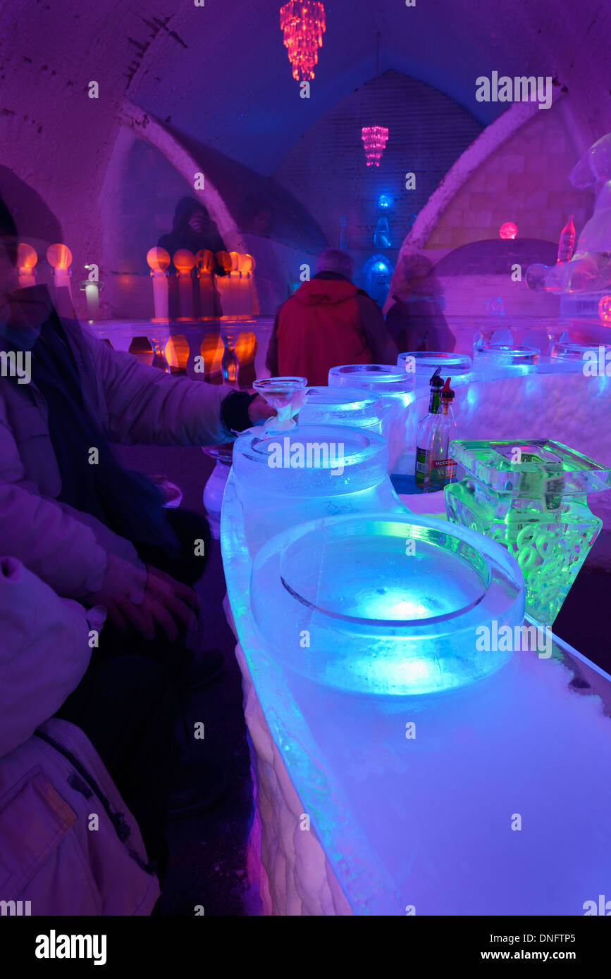 Guests enjoying an appletini drink at the blue ice bar at the Aurora Ice Museum Chena Hot Springs Alaska USA - Stock Image