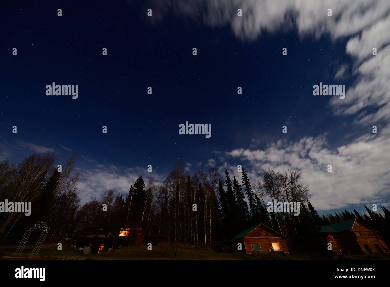 Night sky with stars at full moon over cabins at Fox Alaska USA in the Fall - Stock Image