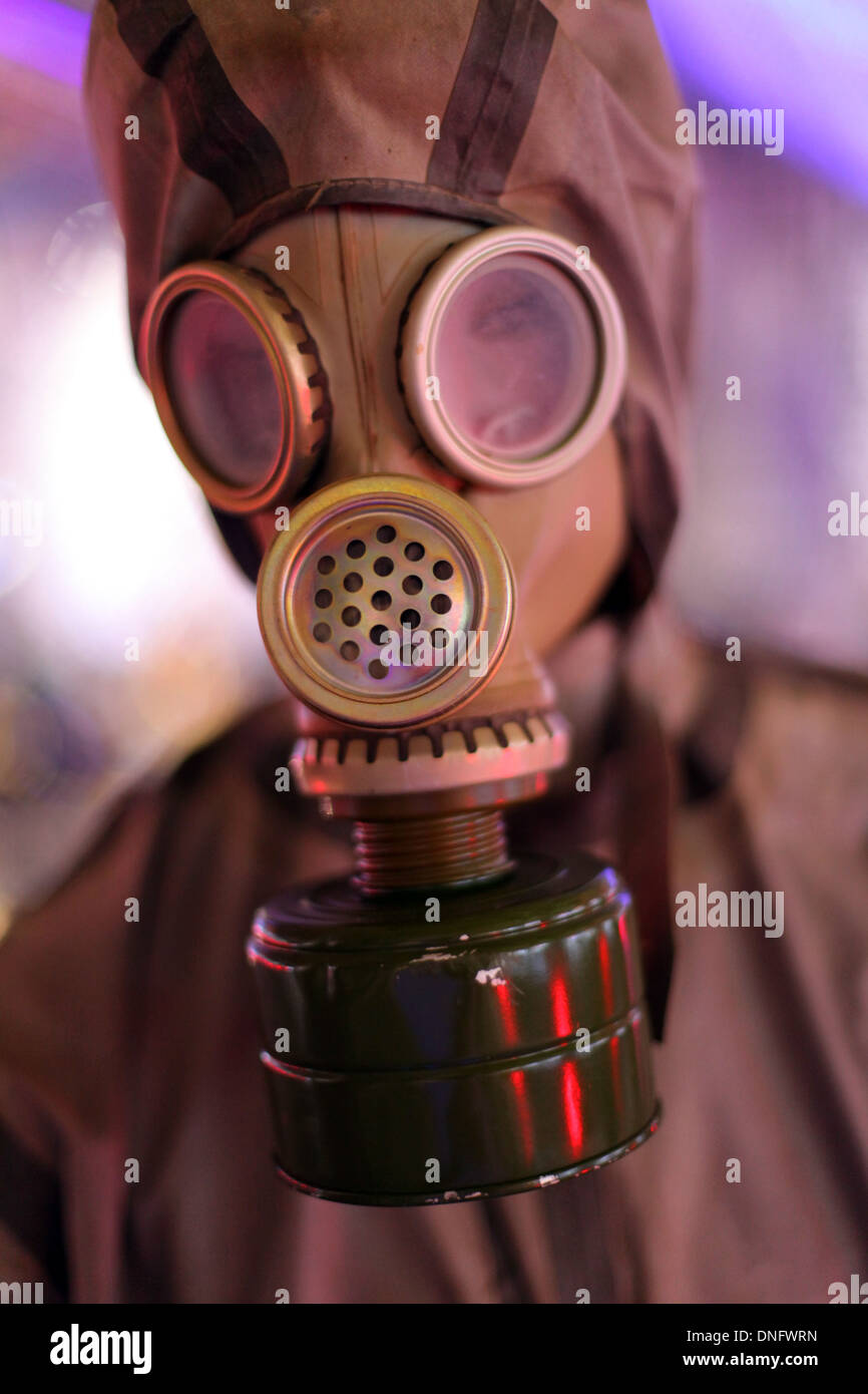 Gas mask and chemical suit - Stock Image